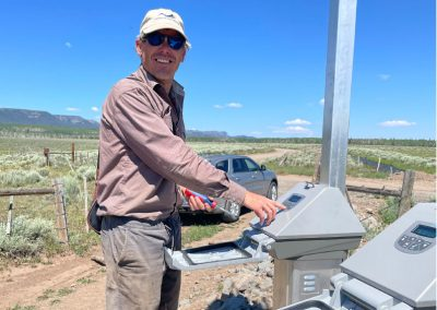 Man operating controlling diversion computer in the field.