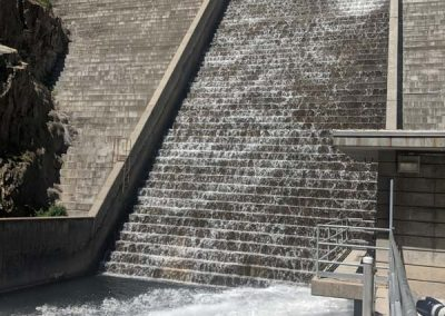 Water running through dam over flow.
