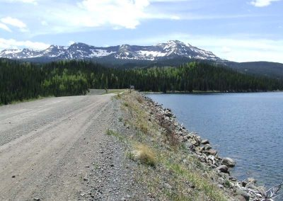 Yamcolo Reservoir dam road with Flat Tops in the background.